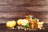 Ice tea in glasses with lemon and mint leafs on wooden table - 216634080