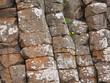 Leinwanddruck Bild - Steinformation aus eckigen Steinen an der Küste von Nordirland