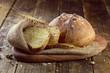 Leinwanddruck Bild - baked bread on wooden table background