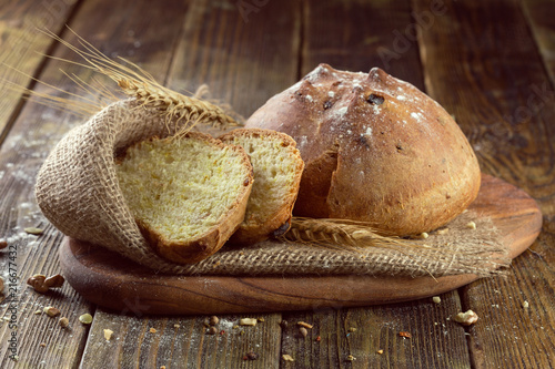Leinwanddruck Bild baked bread on wooden table background