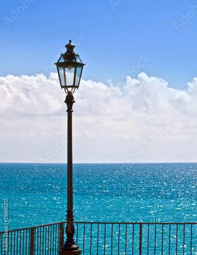 Fotobehang Liguria Ligurian sea, vivid blue waters from a coastal promenade in a bright day of summer