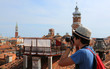 Young photographer takes many pictures in Venice