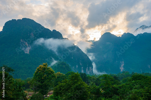 Foto Spatwand Groen blauw Landscape of mountains and clouds Green tree in the rainy season