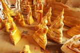 many small size gold Buddha statue