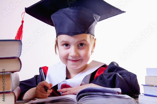 Foto Murales Curriculum vitae of judge. Portrait of serious child girl judge (lawyer) answers biographical questionnaire. Humorous photo.
