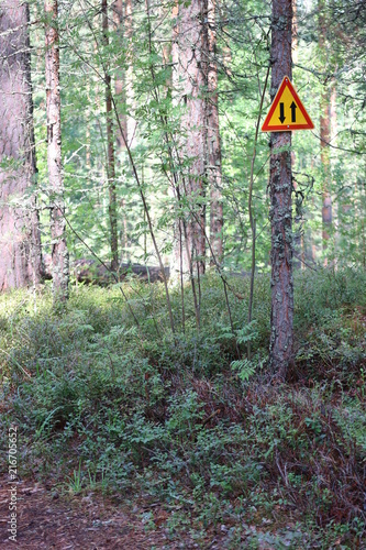 Aluminium Olijf Bycicle road sign on wood path in Finland