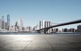 Fototapeta Nowy York - empty street with modern city new york as background © zhu difeng