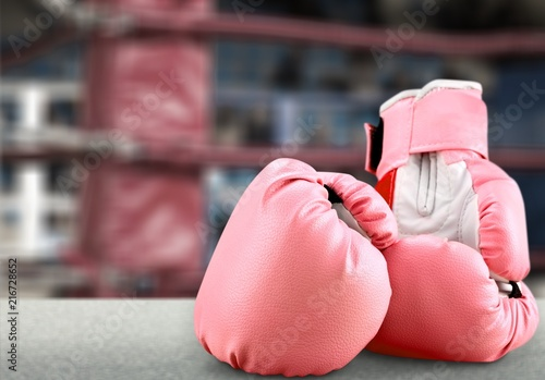 Pink boxing gloves on desk