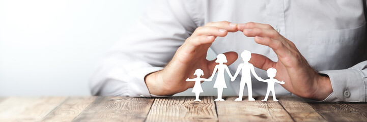 Protecting Hands Over Paper Family / Family Protection And Care Concept