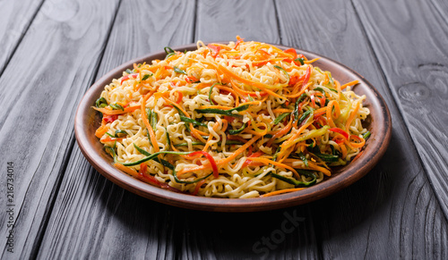 Asian noodles salad in bowl