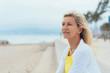Leinwanddruck Bild - Thoughtful older woman on a seafront promenade