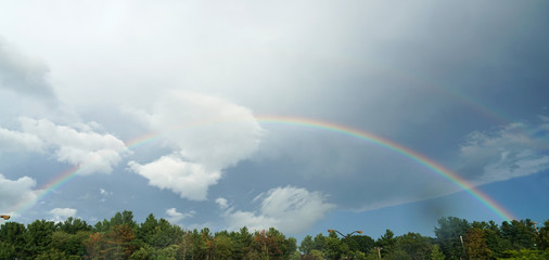 landscape of rainbow in the sky after thunderstorm