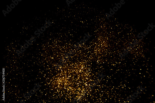 Foto Murales Abstract gold background. Glitter vintage lights background.