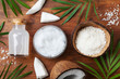 Leinwanddruck Bild - Set of organic coconut products for spa treatment, cosmetic or food ingredients. Oil, water and shavings top view. Flat lay.