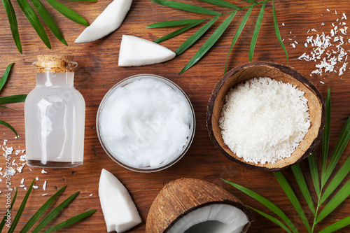 Leinwanddruck Bild Set of organic coconut products for spa treatment, cosmetic or food ingredients. Oil, water and shavings top view. Flat lay.