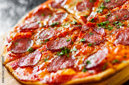 sliced Pepperoni Pizza with Mozzarella cheese, salami, Tomatoes, pepper, Spices and Fresh Basil. Italian pizza - 216788898