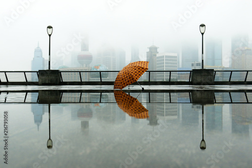 Fotobehang Shanghai Reflection of an umbrella in water , in front of the building of Pudong,Shanghai, China