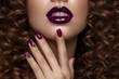 Leinwanddruck Bild - Beautiful girl with evening make-up, purple lips, curls and design manicure nails. beauty face. Photos shot in studio.