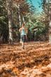 Leinwandbild Motiv Woman Jogging Outdoors in The Fall