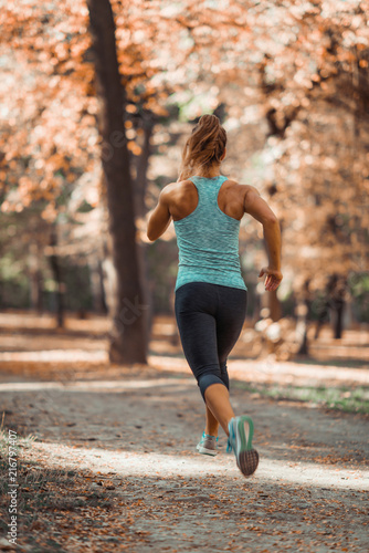 Leinwanddruck Bild Woman Jogging Outdoors in The Fall