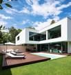Leinwanddruck Bild - Exterior modern white villa with pool and garden