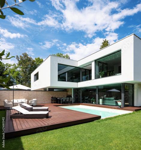 Exterior modern white villa with pool and garden - 216803412