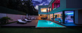 Modern villa with colored led lights at night - 216803601