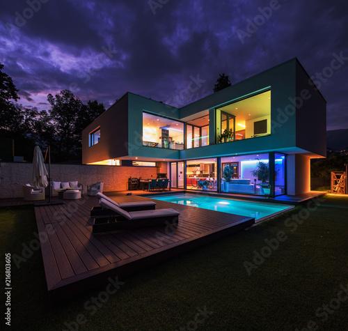 Leinwandbild Motiv Modern villa with colored led lights at night