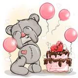 Teddy bear birthday boy gets a cake as a gift