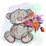 Teddy bear sitting with a bouquet