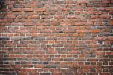 Old worn brick wall exterior pattern texture background
