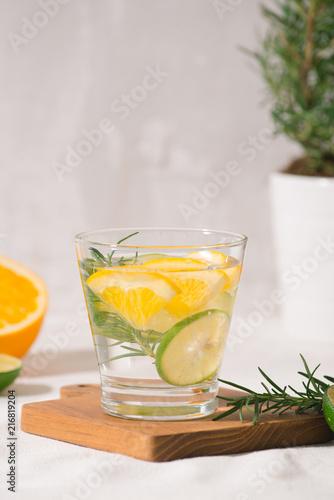 Foto Murales Fresh summer lemonade with citrus, orange and rosemary