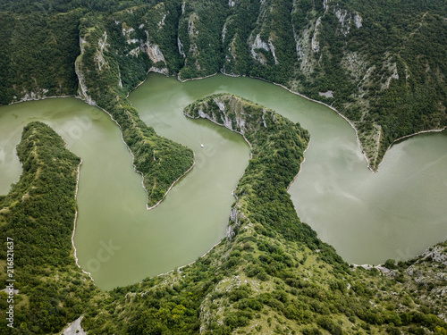 Foto Spatwand Olijf The Uvac gorge in southern Serbia is especially known for entrenched meanders in a 100 m (330 ft) deep canyon. It is a nature reserve for the preservation of the griffon vulture.