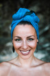 Headshot of a gorgeous smilling woman with headscarf. Real emotions.