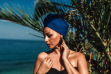 Summer portrait of an elegant woman by the sea. - 216823281
