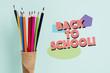 Leinwandbild Motiv pencils in a waffle cone and text back to school