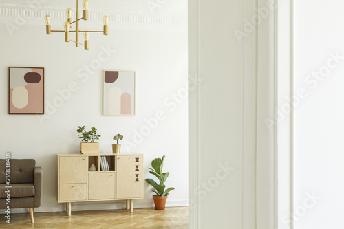 Retro Style Apartment Interior With A Minimalist Wooden Cabinet In