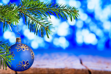 Blue Christmas Ball with Christmas Twig on the Blue Background