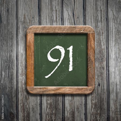 digit on a green blackboard - 216841221
