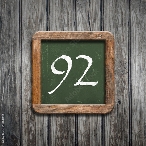 digit on a green blackboard - 216841258