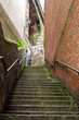 Deserted Narrow Stairway Between Brick Walls