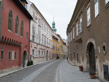 Old buildings line a pedestrian street of the old town in Sopron, Hungary