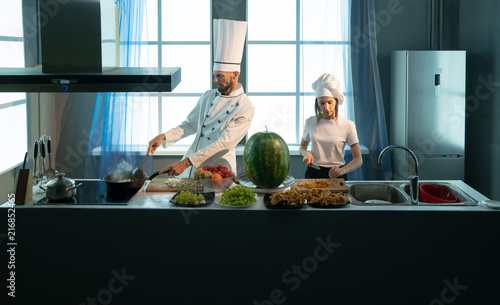 Fridge magnet Cook and assistant student prepare food