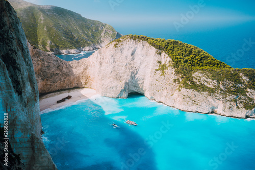 Foto Spatwand Turkoois Navagio beach, Zakynthos island, Greece. Two tourist boats leaving Shipwreck bay with turquoise water and white sand beach. Famous landmark location in Greece
