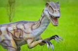 Big model of velociraptor in nature