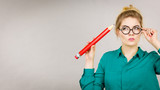 Woman confused thinking, big pencil in hand - 216874815