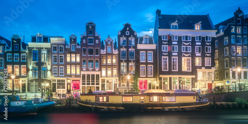 River, traditional old houses and boats, Amsterdam