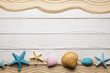 Seashells, beach sand and wooden planks - 216880694