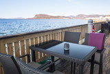 Table at the sea in Alesund town, Norway - 216882042