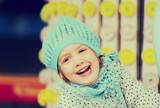 child having ride on the merry-go-round - 216882431